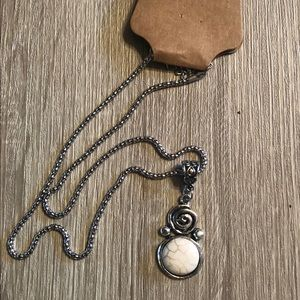 Silver spiral necklace with white stone